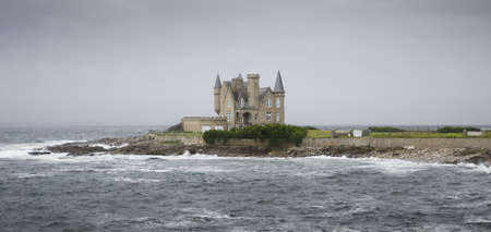 Beautiful castle in the sea during a storm, in Quiberon, France
