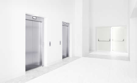 Two modern elevators and an open exit door photo