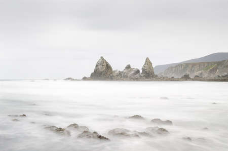 Long exposure on the coast. Photo taken on the coast of Galicia, Spain during a cold day Stock Photo