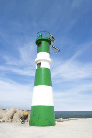 Small lighthouse in green and white