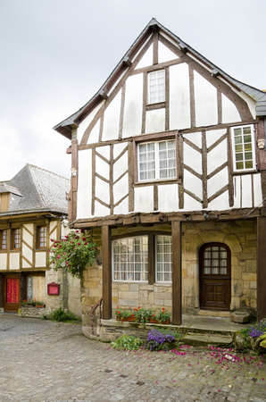 Crooked and colorful medieval houses in Rochefort en Terre, Britanny, France Stock Photo - 14511424