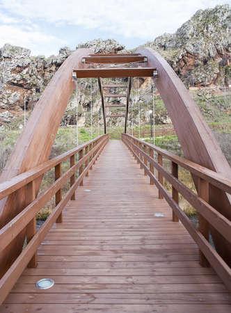 Wooden bridge in the mountain Stock Photo