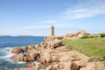 Beautiful Lighthouse. Mean Ruz Lighthouse, pink granite coast at Brittany, France