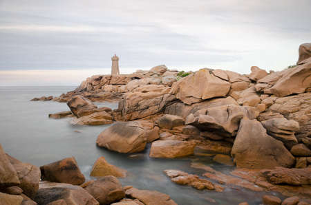 cote de granit rose: Beautiful Lighthouse. Mean Ruz Lighthouse, pink granite coast at Brittany, France, during the dusk Stock Photo