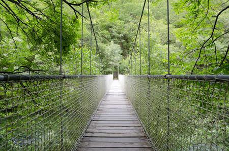 Suspension bridge, rope bridge  Wooden bridge or walkway through the mountain