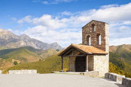 Church surrounded by Autumn foliage and Picos de Europa Mountains, Spain. Beautiful Santo Toribio de Liebana Church Stock Photo - 15145181