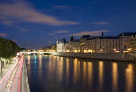 Seine River with the Sainte-Chapelle and the Conciergerie in the background at night, Paris