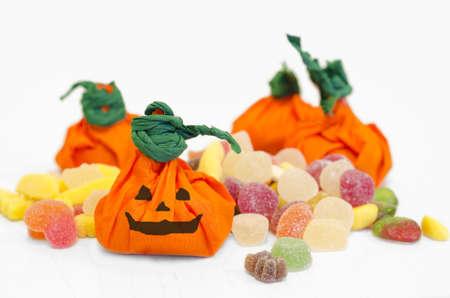 Halloween Pumpkins with candies. Orange pumpkins. Studio shot of pumpkins with candies in white background. Hand made pumpkins