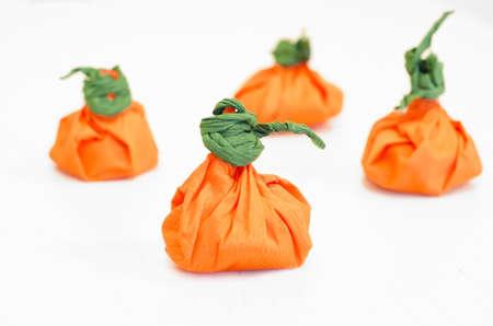 Halloween Pumpkins. Orange pumpkins. Studio shot of pumpkins in white background. Hand made pumpkins