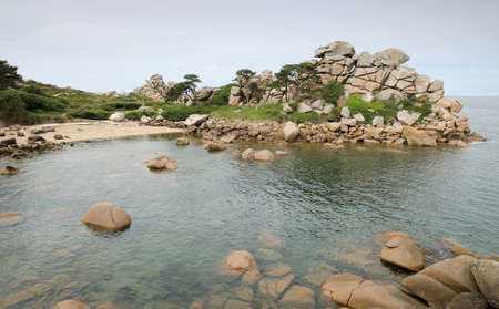 cote de granit rose: Beautiful,lonely and calm beach with big rocks. Tranquil scene. Pink granite coast, Ploumanach, Brittany, France. Stock Photo
