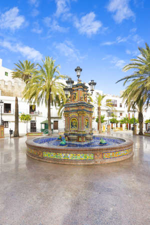 Ceramic fontaine in Vejer de la Frontera, typical spanish village with white houses photo