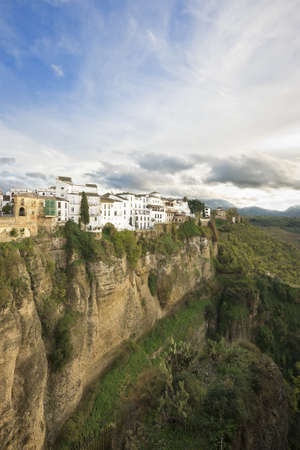 Typcal white spanish houses in Ronda, Malaga, Andalusia, over the scarped cliffs Stock Photo
