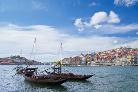 rabelo: Porto city and river Douro  Oporto City, three  rabelo  boats in the River Douro at day, framed by the old city
