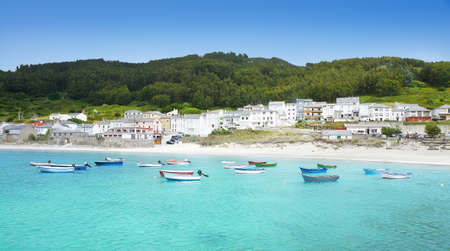 Spanish fishing village. Beautiful landscape with transparent turquoise sea and lots of colorful boats.