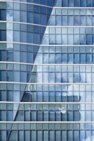 Skyscraper facade, close up  Wall of office building with blue windows Stock Photo
