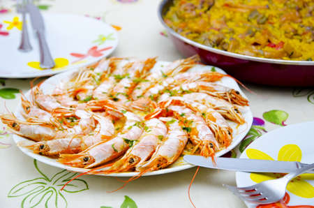 Food on table, ready to eat  Paella, typical spanish foodand cooked shrimps  photo