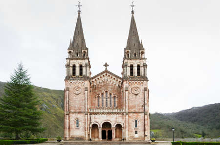 covadonga: Country Church  Beautiful ancient church  Spanish Covadonga church in the mountain  Basilica of Our Lady of Battles in Covadonga, Asturias, Spain  Stock Photo