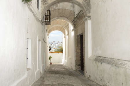 Old narrow street in Spain  Vejer de la Frontera village, Andalusia, Spain  Typical white spanish houses
