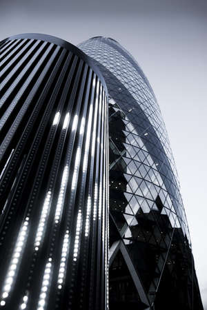 Modern buildings  30 St Mary Axe in London, UK, Swiss Re Building or informally called the Gherkin Stock Photo - 19010141