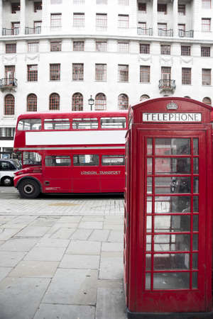 London Red Telephone Booth and Red Ancient Bus on the street