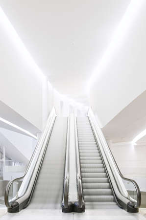 Empty escalator in futuristic building. Escalator in modern building, architecture
