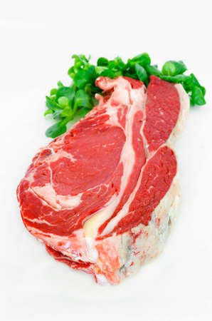 Pieces of crude meat, beef steak on white  Isolated Stock Photo