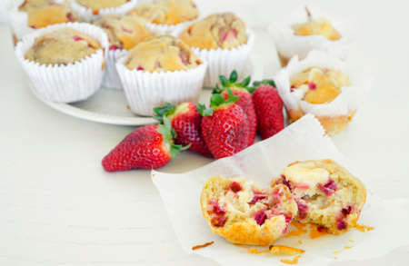 Homemade strawberry muffins in paper cupcake cases Stock Photo