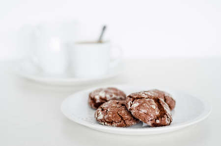 crinkles: Chocolate crinkles cookies on a plate, white background  Selective focus