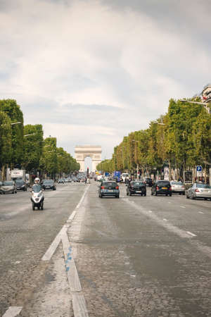 PARIS, FRANCE - OCTOBER 3  The Champs-Elysees and the Arc de Triomphe, onOctober 03, 2010 in Paris, France  The most famous avenue of Paris has 1910m and has a lot of traffic  Editorial