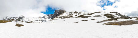 Panorama of Snow Mountain Range Landscape with Blue Sky from Fuente De, Picos de Europa, Spain
