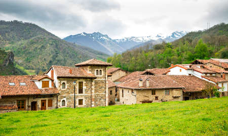 Mogrovejo Village in front of the Picos de Europa, Cantabria, Spain. Mountain landscape. Stock Photo