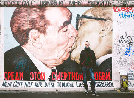 BERLIN, GERMANY - NOVEMBER 14: Berlin Wall graffiti seen on NOVEMBER 11, 2014, Berlin, East Side Gallery. Its a 1.3 km long part of original Berlin Wall which collapsed in 1989. Editorial