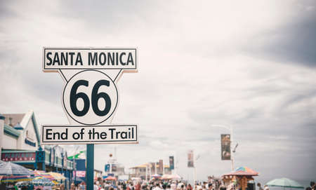 LOS ANGELES - SEP 15:  Historic Route 66 sign at Santa Monica Pier, September 12, 2015 in Los Angeles. U.S. Route 66 originally ran from Chicago ending at Santa Monica, California.