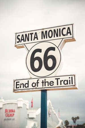 LOS ANGELES - SEP 15:  Historic Route 66 sign at Santa Monica Pier, September 12, 2015 in Los Angeles. U.S. Route 66 originally ran from Chicago ending at Santa Monica, California.