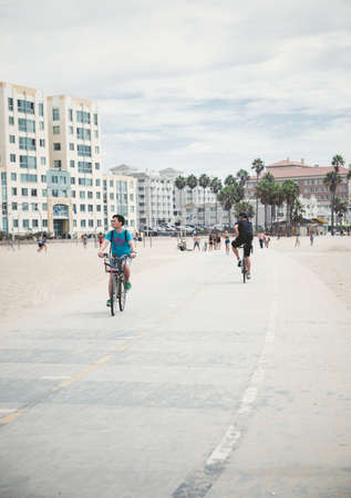 HOLLYWOOD - SEPTEMBER 12: Bikers on Venice Beach Boardwalk on September 12, 2015 in Venice, California. Venice Beach includes the promenade that runs parallel to the beach or just the boardwalk, Muscle Beach, the handball courts, the paddle tennis courts  Editorial