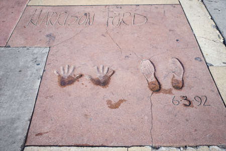 LOS ANGELES - SEPTEMBER 12: Harrison Ford handprints-footprints in Hollywood Boulevard on September 12, 2015 in Los Angeles. There are nearly 200 celebrity handprints in the concrete of Chinese Theatres forecourt. Editorial