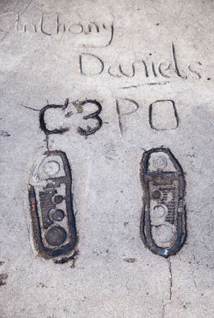 LOS ANGELES-SEPTEMBER 12:Anthony Daniels C3PO footprints in Hollywood Boulevard on September 12, 2015 in Los Angeles. There are nearly 200 celebrity handprints in the concrete of Chinese Theatres forecourt.