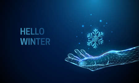 Abstract low poly giving hand with falling snowflake