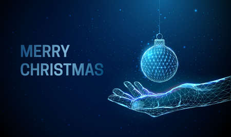 Abstract low poly giving hand with Christmas ball.