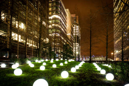 docklands: London, United Kingdom - January 11, 2016: Winter Lights Festival at Canary Wharf, Docklands. Globoscope installation made of of luminous spheres representing digitised landscape.