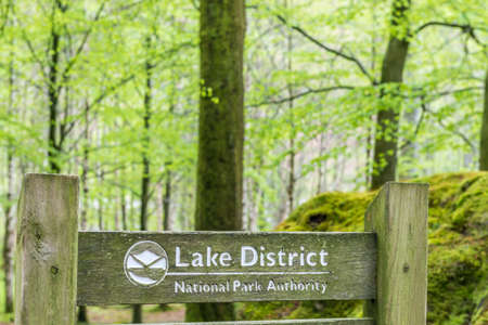 cumbria: Lake District, United Kingdom - May 09, 2015: Lake District Penny Wood Rock sign