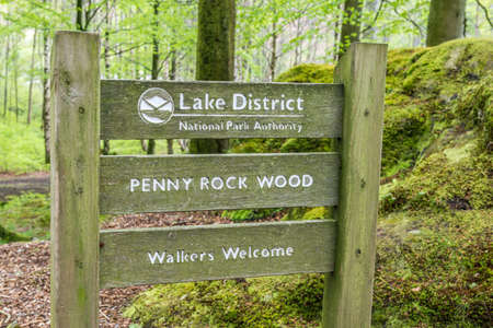 lake district: Lake District, United Kingdom - May 09, 2015: Lake District Penny Wood Rock sign