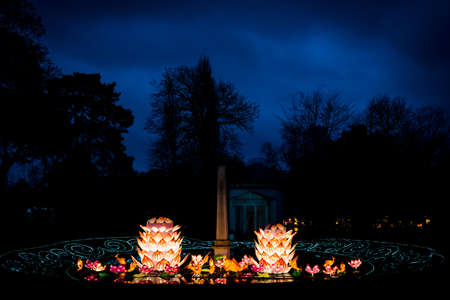 lotus lantern: London, United Kingdom - February 07, 2016: Magical Lantern Festival at Chiswick House And Gardens. Lotus flowers and coy fish installation.