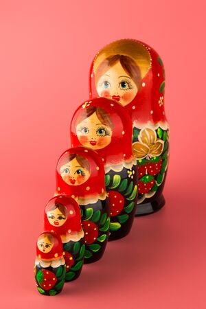 Russian folk wooden doll painted with paints