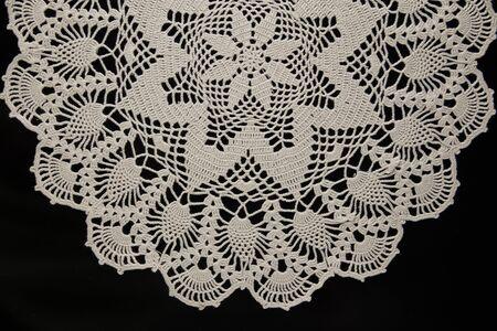 white lace on black background, crochet