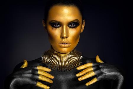 Beautiful woman portrait in gold and black colors Reklamní fotografie