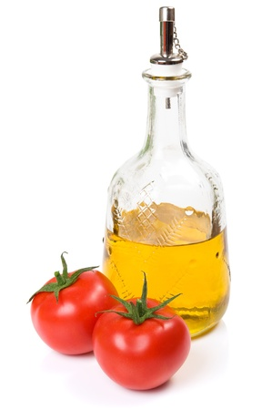 Tomatoes and olive oil isolated on the white photo
