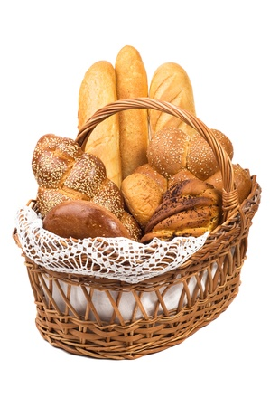 Fresh bread in the basket fully isolated. photo