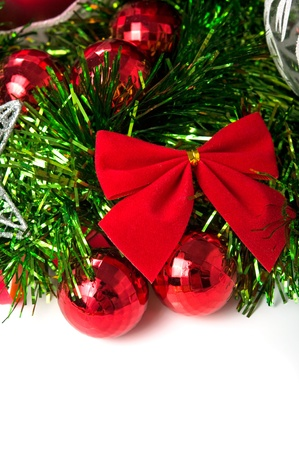 Red xmas bow and baubles on the white with space for text Stock Photo