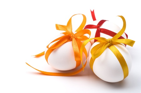 Easter holiday eggs with bows and space for text